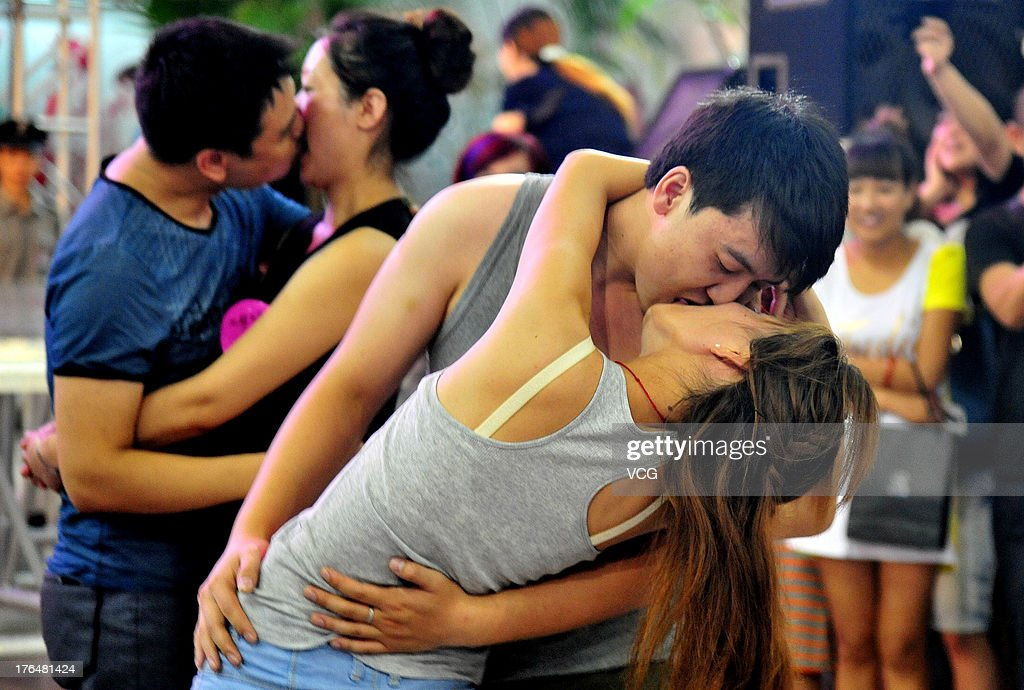 Chinese lovers kiss during a competition to greet the Chinese Valentine's Day on August 13, 2013 in Shenyang, China. The Chinese Valentine's Day falls on the 7th day of the 7th month on the Chinese lunar calendar which falls on August 13 this year.