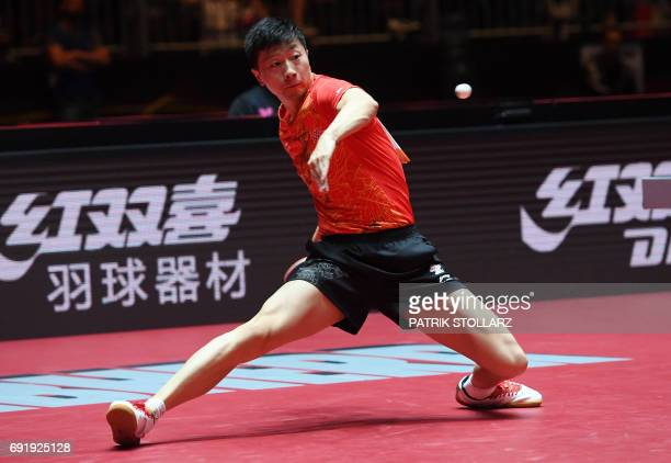 Chinese Ma Long plays against Taiwan's Chuang ChihYuan during the round of 16 match during the WTTC World Table Tennis Championships in Duesseldorf...