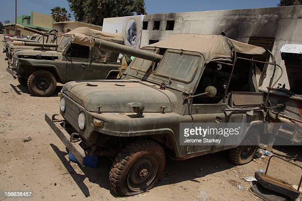 Chinese made BJ-212 canvas-topped jeeps with canons, lie dilapidated and covered with dust in a former army barracks, turned rebel training camp in...