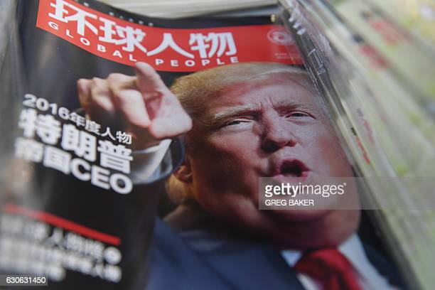 A Chinese magazine with a front page story naming US Presidentelect Donald Trump as their Person of the Year is seen at a news stand in Beijing on...