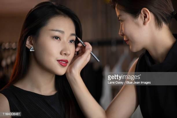 chinese makeup artist applying makeup on model - 女優 ストックフォトと画像