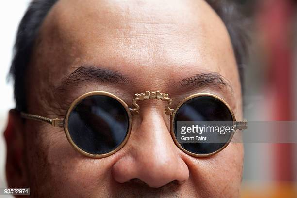 chinese male with old style glasses