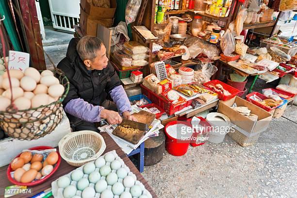 chinese man chopping food street market stall hong kong china - wanchai stock photos and pictures