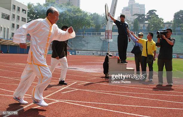 Chinese man Guo Cairu 105yearsold gets off the mark during an activity in which he challenges the 100 meter run record for centenarians on May 10...
