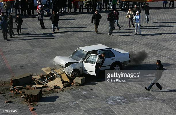 Chinese man Hou Jun drives a Jetta car into a barrier during a live crash test in the Changchun Automotive Cultural Park on November 18 2007 in...