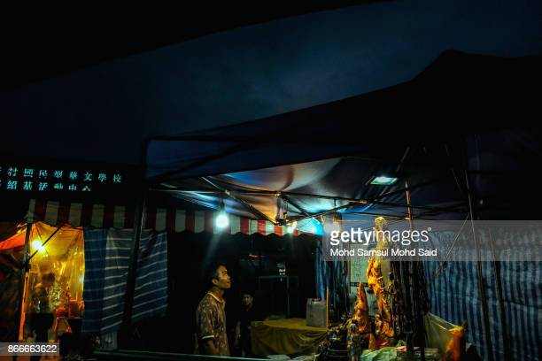Chinese man is seen performing a prayer during The Nine Emperor Gods Festival inside the temple on October 26 2017 in Kuala Lumpur Malaysia The Nine...
