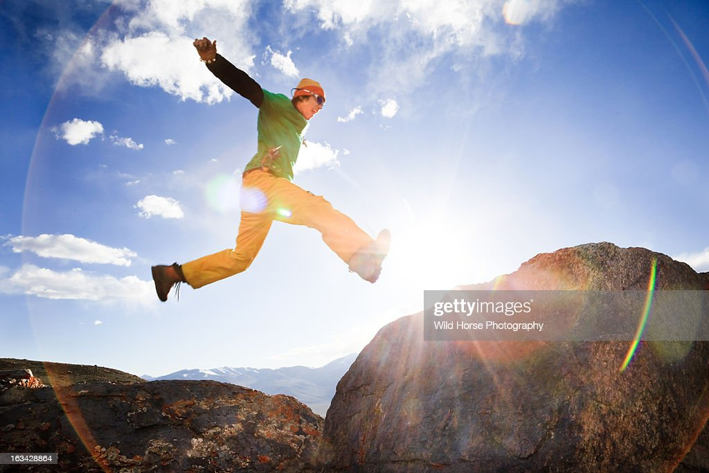 Chinese man jumping in the sky : Stock Photo