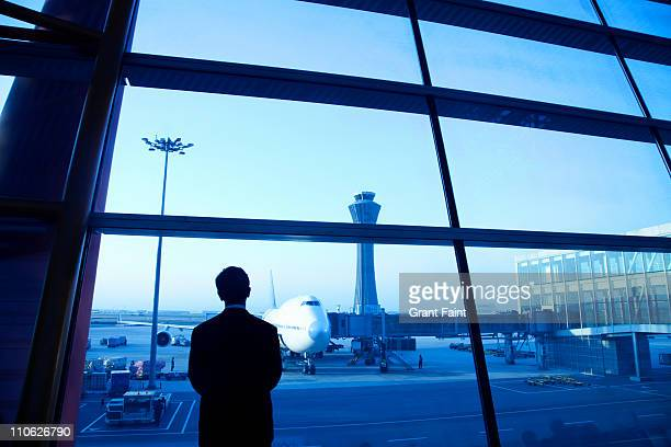 Chinese man looking at airplane.