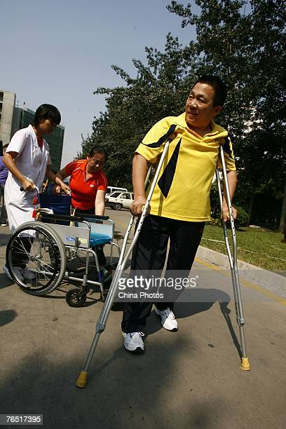 Chinese man Peng Shuilin whose body was severed in half in a traffic accident walks with artificial legs as he leaves the China Rehabilitation...