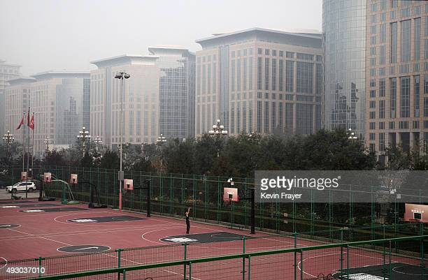 Chinese man plays basketball during a polluted morning on October 17 2015 in Beijing China As a result of industry the use of coal and automobile...