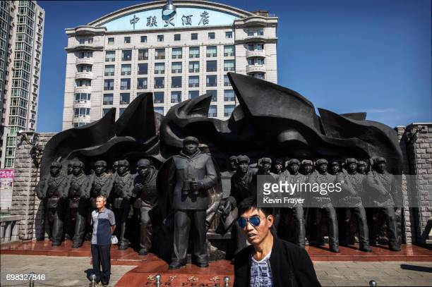 Chinese man poses in front of a monument commemorating the Korean War on the Yalu river in the border city of Dandong, Liaoning province, northern...