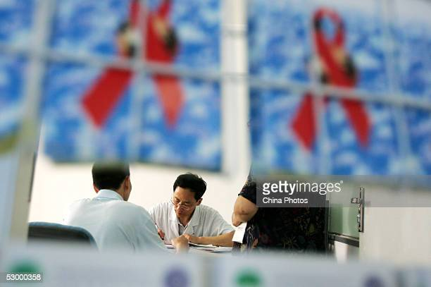 A Chinese man registers to get methadone maintenance therapy as a doctor records his information at the Wuhou District People's Hospital on May 30...