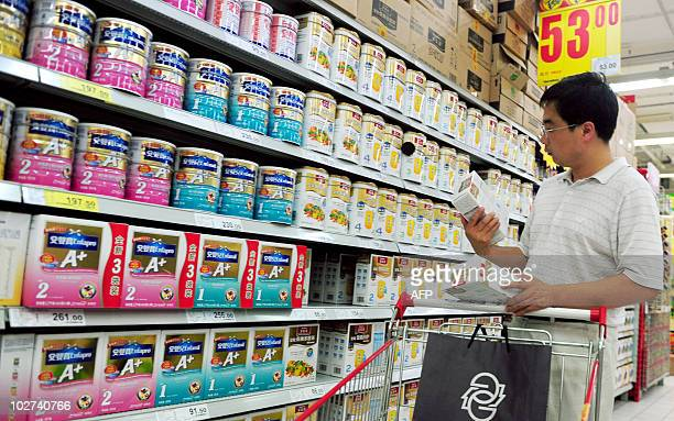 A Chinese man selects milk powder at a supermarket in Beijing on July 9 2010 Chinese authorities have seized 76 tonnes of milk powder tainted with...