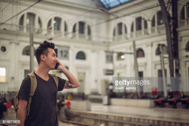 chinese man standing on a train station - one man only stock pictures, royalty-free photos & images