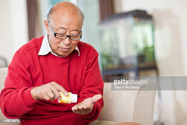 chinese man taking medication - taking a pill stock pictures, royalty-free photos & images