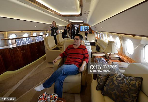 A Chinese man tries out the interior on an Airbus A319 private business jet during the Asian Business Aviation Conference and Exhibition at the...