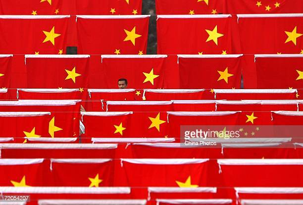 A Chinese man visits a national flag show at Chaoyang park September 30 2006 in Beijing China Chinese people are preparing for National Day...