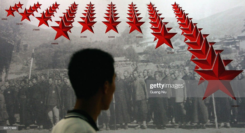 A Chinese man visits an exhibition to commemorate the 60th anniversary of the victory against Japanese occupation during World War II on July 1, 2005 in Beijing, China. Chinese authorities have started to organise various events to mark the 60th anniversary in China's capital. China has claimed that Japan has never sufficiently atoned for its brutal occupation.