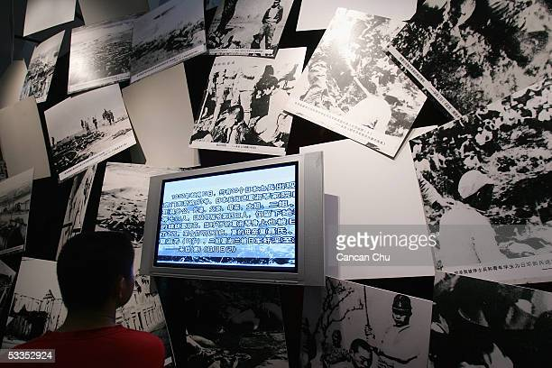 Chinese man visits the exhibition of historical facts on the 1937 Nanjing Massacre at the National Museum August 11 2005 in Beijing China The 20day...