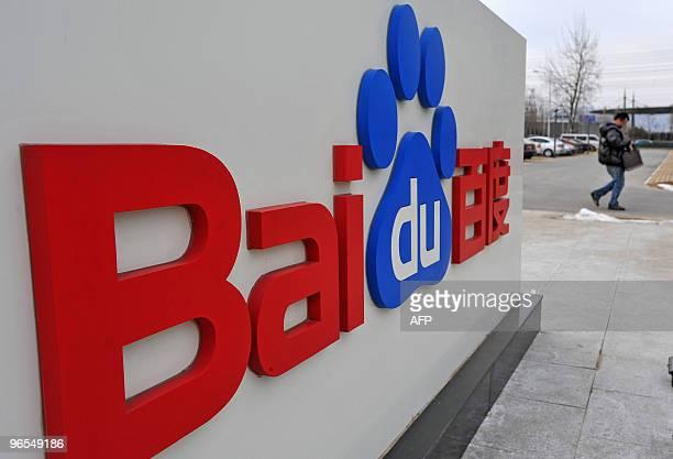 Chinese man walks pass the Chinese Web search giant Baidu's headoffice in Beijing on February 10, 2010. The Nasdaq-listed Baidu said net profit rose...