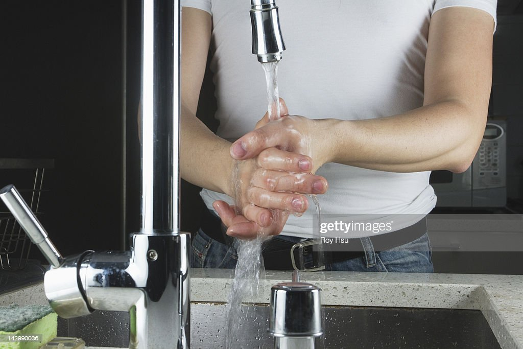 Chinese Man Washing His Hands In Kitchen Sink Stock Photo | Getty Images