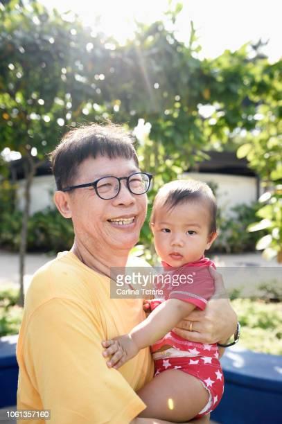 chinese man with his grandson - シンガポール文化 ストックフォトと画像