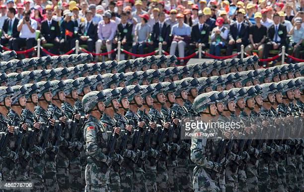 Chinese march in formation passed Tiananmen Square and the Forbidden City during a military parade on September 3 2015 in Beijing China China is...
