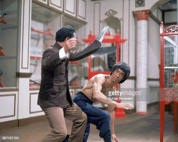 Chinese martial artists and actors Kien Shih and Bruce Lee on the set of Enter the Dragon directed by Robert Clouse