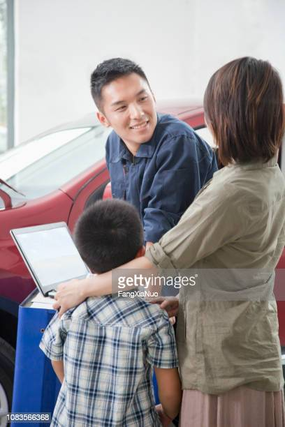 Chinese mechanic talking to family