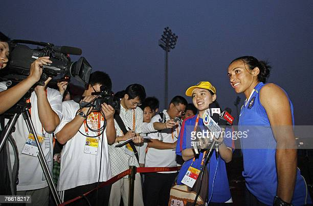 Chinese media gather to interview Brazil's Marta Silva winner of FIFA Women's World Player of 2006 award after a training session for the Women's...