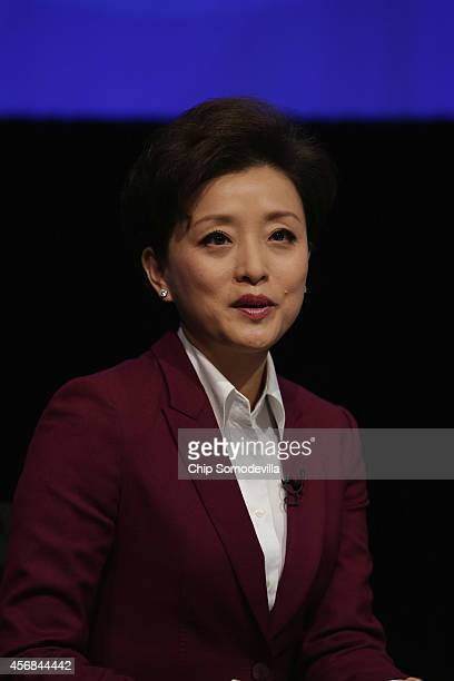 Chinese media star Yang Lan moderates a discussion about the World Bank's goal of reducing poverty in an unequal world economy at the World Bank...