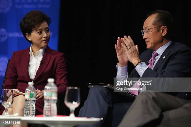 Chinese media star Yang Lan moderates a discussion World Bank Group President Jim Yong Kim about the bank's goal of reducing poverty in an unequal...
