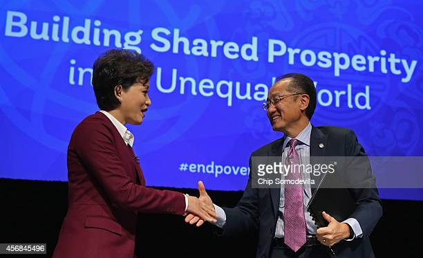 Chinese media star Yang Lan shakes hands with World Bank Group President Jim Yong Kim after a discussion about the bank's goal of reducing poverty in...