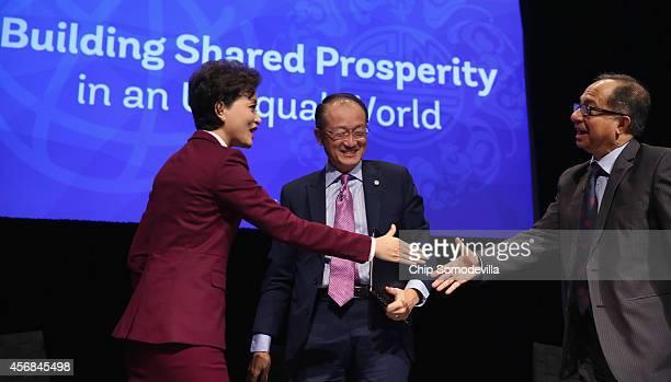 Chinese media star Yang Lan World Bank Group President Jim Yong Kim and World Bank Group Chief Economist Kaushik Basu shake hands after a discussion...