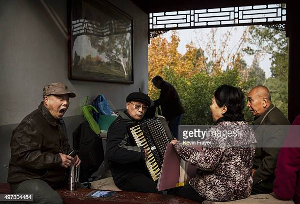 Chinese men and women sing traditional Communist Party folk songs at a local park on November 15 2015 in Beijing China