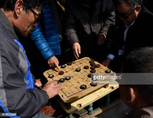 Chinese men play Chinese chess in the parkland surrounding the Temple Of Heaven on April 4 2017 in Beijing China