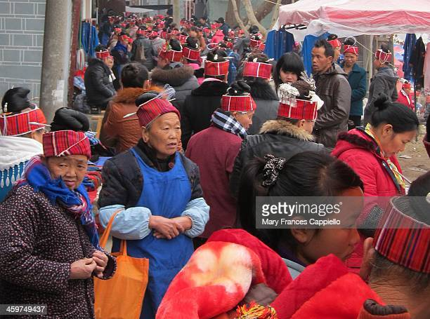Chinese Miao minority women in Shidong, Guizhou shop at the weekly market. Shidong is where they buy the silver ornaments they wear in their hair....