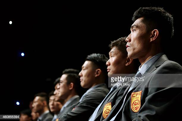 Chinese midfielder Zheng Zhi sits with his teammates during a promotion event at a television studio in Guangzhou on December 27 2014 China said it...
