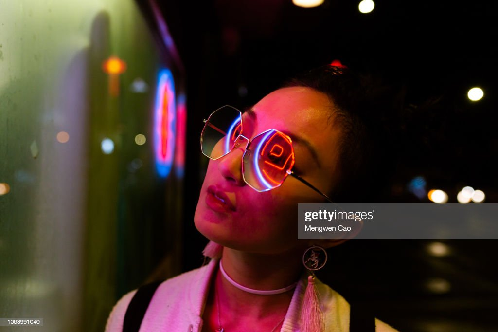 portrait of young woman under neon light : Stock Photo