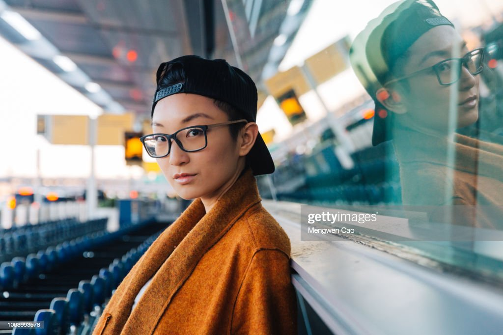 Young woman waiting outside the airport