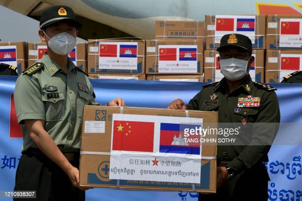 Chinese military attache Li Jing Feng presents aid including medical equipment to Cambodia's General Nem Sowath to help in the effort to contain the...