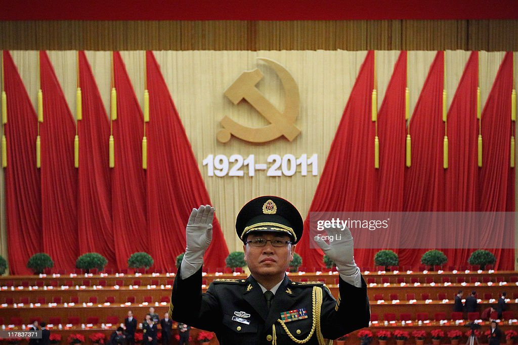 A Chinese military band conductor rehearses ahead of the celebration of the Communist Party's 90th anniversary at the Great Hall of the People on July 1, 2011 in Beijing, China.