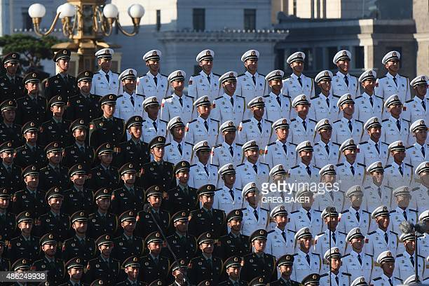 A Chinese military choir stands in position ahead of a military parade later in the morning at Tiananmen Square in Beijing on September 3 to mark the...