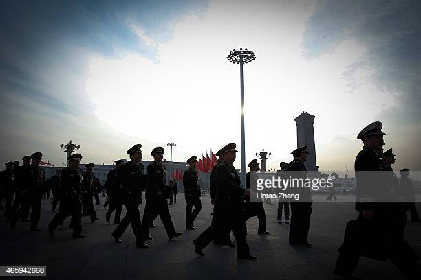 Chinese military delegates arrive at the Great Hall of the People before the third plenary session of China's parliament the National People's...