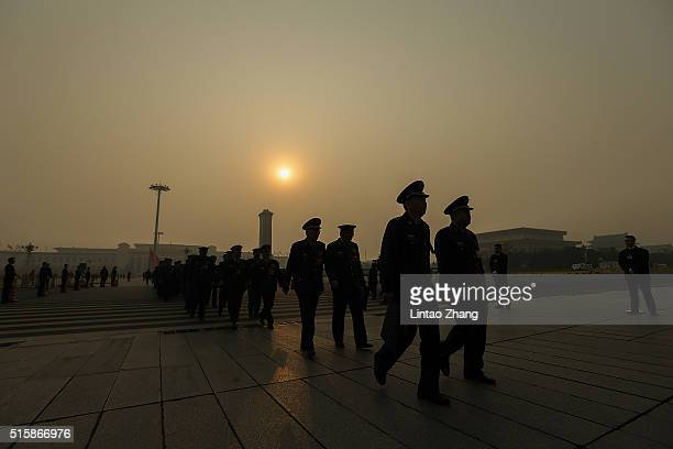 Chinese military delegates arrive at the Great Hall of the People before the closing session of the National People's Congress on March 16 2016 in...