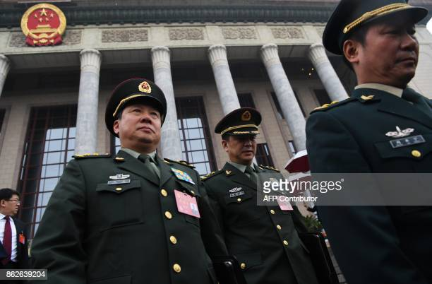 Chinese military delegates leave after the opening cereony of the 19th Communist Party Congress in Beijing's Great Hall of the People on October 18...