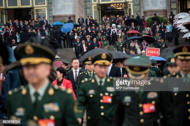 Chinese military delegates leave after the speech of Chinese President Xi Jinping at the Communist Party's 19th Congress in Beijing on October 18,...