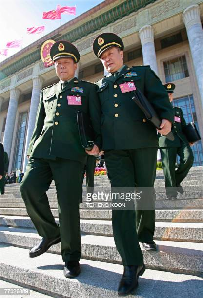 Chinese Military delegates leave the Great Hall of the People after the 17th Communist Party Congress in Beijing 15 October 2007 Chinese President Hu...