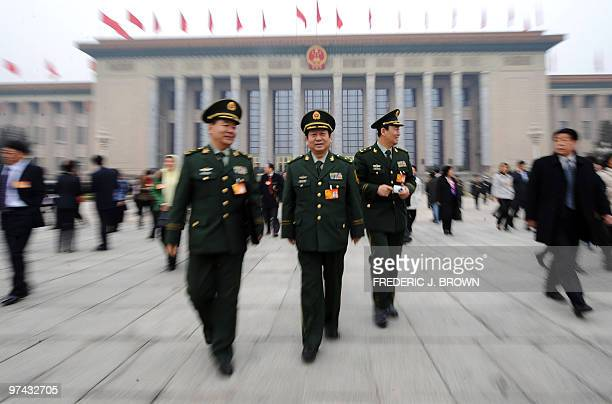 Chinese military delegates walk on Tiananmen Square from the Great Hall of the People in Beijing on March 4 2010 a day before the opening session of...
