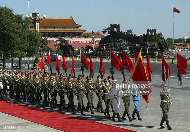 Chinese military honour guards march past the Great Hall of the People during a welcoming ceremony for visiting Canadian Prime Minister Jean Chretien...